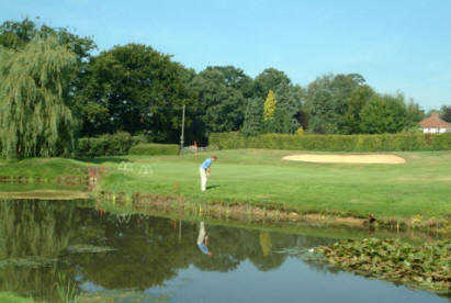 A view iver the water of a green at Richmond Park Golf Club
