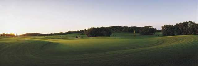 Sunset view of a green at Two Oaks North Golf Club