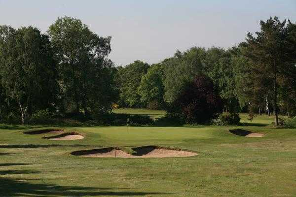 A view of the 3rd green surrounded by bunkers at Fulford Golf Club