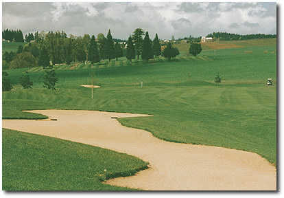 Hole #10 is a straight and relatively long par 5. The driving range is to the left as well as this huge fairway bunker. If you can keep out of here, you can easily make the green in regulation and savor a par.