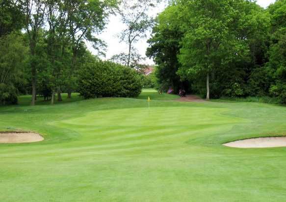 A view of a green guarded by bunkers at Middlesbrough Golf Club