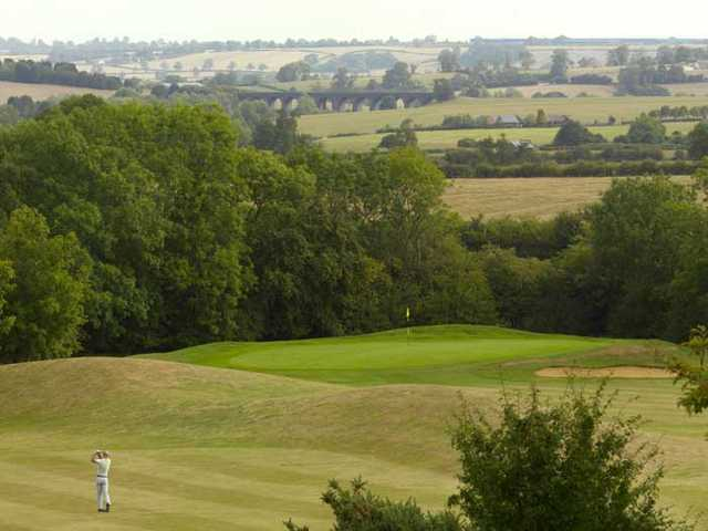 A view of a green guarded by bunker at Hellidon Lakes Golf & Spa Hotel