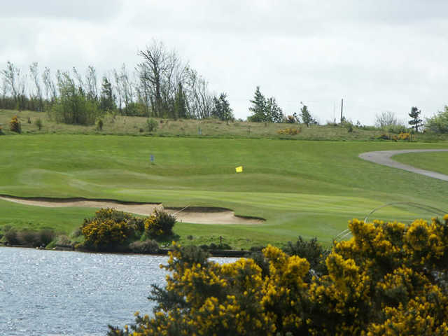 A view over the water of a green at Longhirst Hall Hotel & Golf