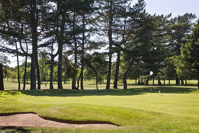 A sunny view of a green at Beeston Fields Golf Club