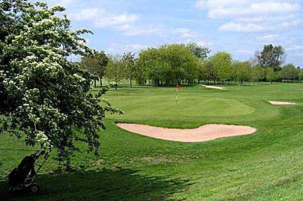 A view of the 16th hole guarded by bunkers at Chilwell Manor Golf Club