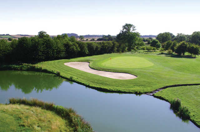 A view over the water of a green at The Nottinghamshire Golf & Country Club