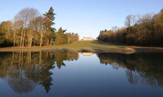 A view over the water of fairway #11 at Heythrop Park Resort