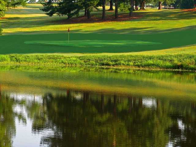 A view over the water of a green at River Bend YMCA Golf Course