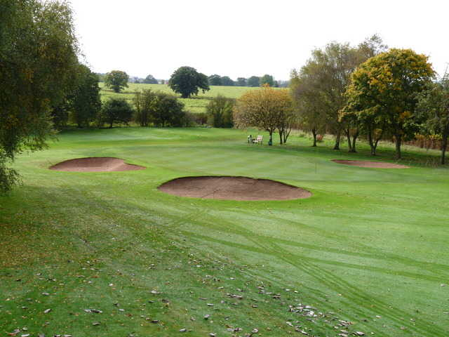 A view of green #10 surrounded by bunkers at Market Drayton Golf Club