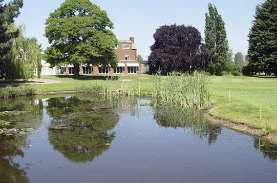 A view over the pond of the clubhouse at Shrewsbury Golf Club