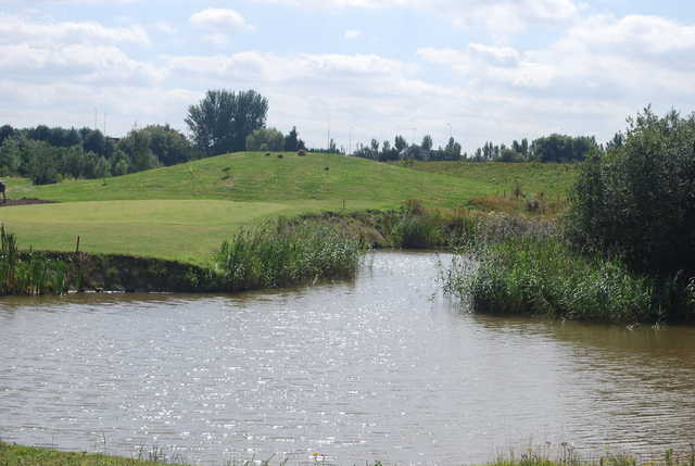 A view over the water of green #9 at Kingswood Golf Centre