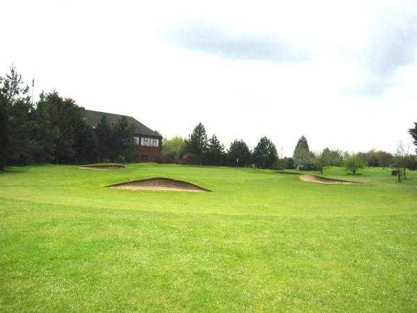 A view of green #14 protected by bunkers at Main Course from Rookery Park Golf Club