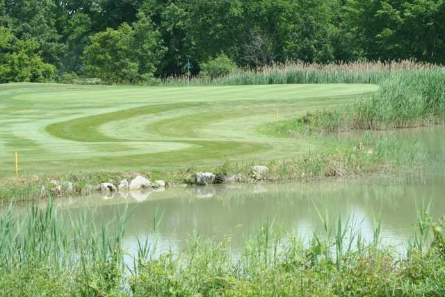 View of a hole and pond at Lake Erie Metropark Golf Course