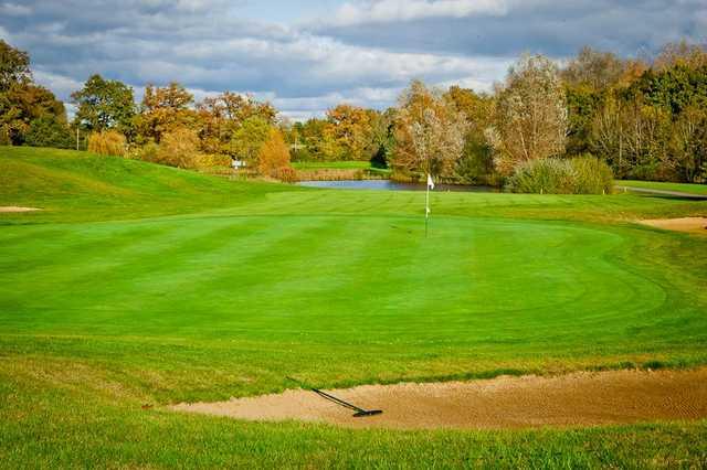 An autumn view of the 15th green at Chobham Golf Club