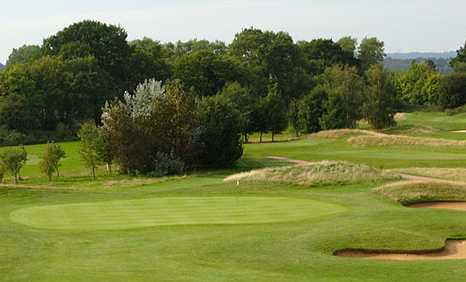 A view of a green protected by tricky bunkers at Milford Golf Club