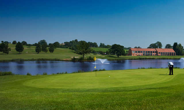 A view of a green with water coming into play at Warwickshire Golf & Country Club