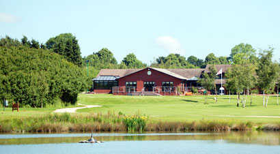 A view over the water of the clubhouse at Calderfields Golf & Country Club