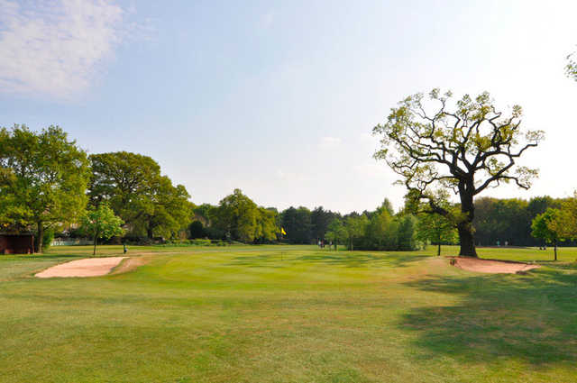A view of the 1st hole flanked by sand traps at Coventry Hearsall Golf Club