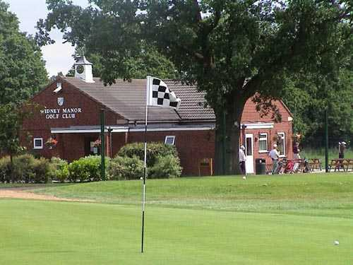 A view of the 18th hole with the clubhouse in background at Widney Manor Golf Club