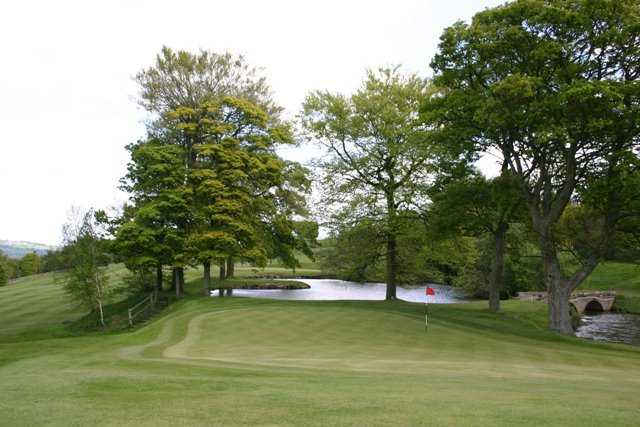A view of a green with water coming into play at Ben Rhydding Golf Club