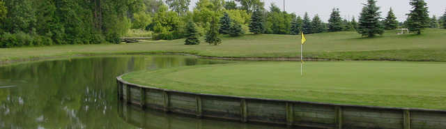 View of the signature 17th island green at Hickory Creek Golf Course