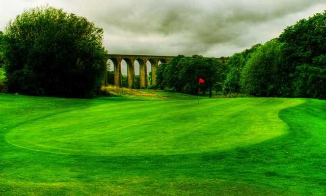 A view of the 7th green with the Thornton viaduct in background at Headley Golf Club