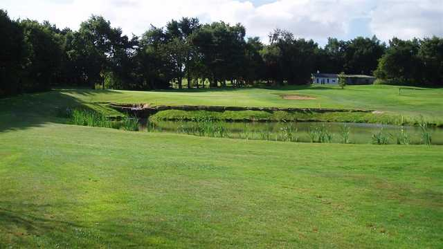 A view over the pond of hole #14 at Scarcroft Golf Club