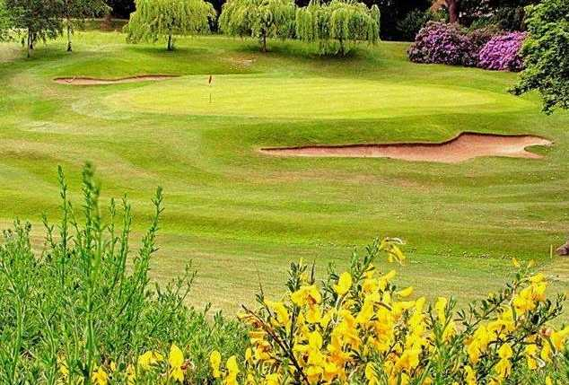A view of a green protected by tricky bunkers at Wakefield Golf Club