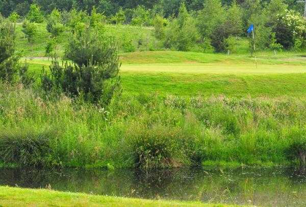 A view over the water of the 2nd hole at Pine Valley Course from Willow Valley Golf