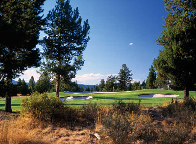 Sunriver Woodlands #12: Keep left off the tee to avoid fairway bunkers to the left and right. Be sure to hit enough club into this elevated green to avoid the bunkers fronting the green