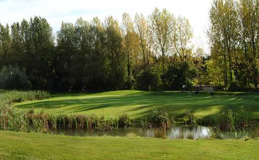 A view of a green with water coming into play at Wrag Barn Golf & Country Club