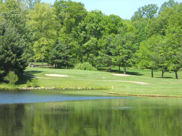 View of green #7 and lake at Woodhaven Country Club
