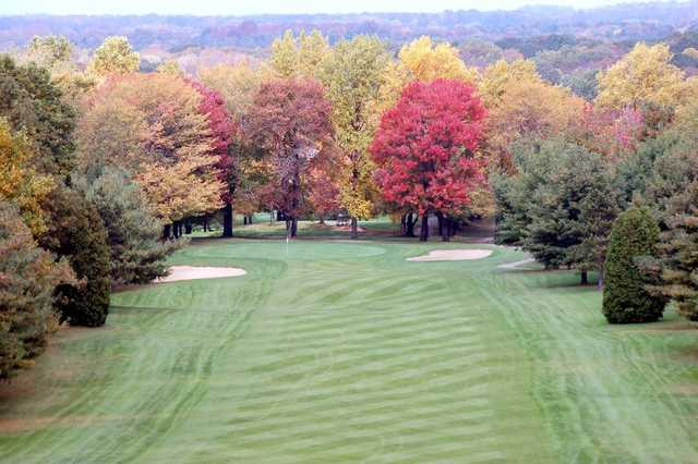 A view of a fairway guarded by colorfull fall trees at Paradise Lake Country Club