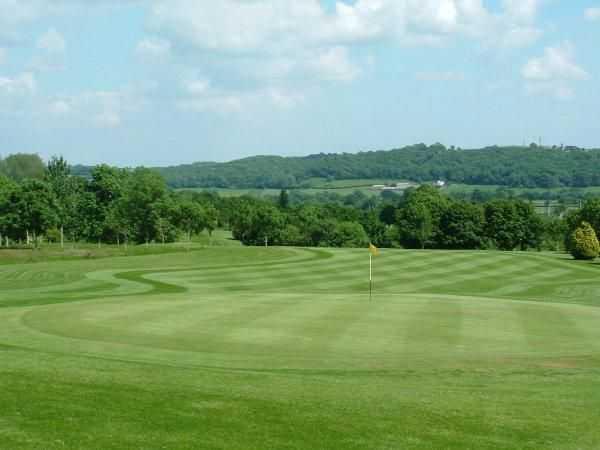 A view of green #18 at Coed-y-Mwstwr Golf Club