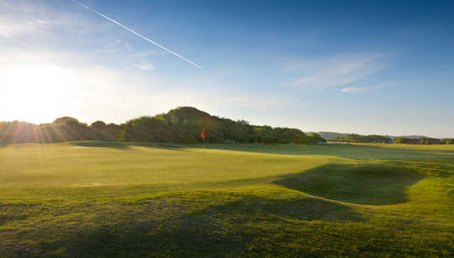 A sunny view of the 10th hole at Pyle and Kenfig Golf Club