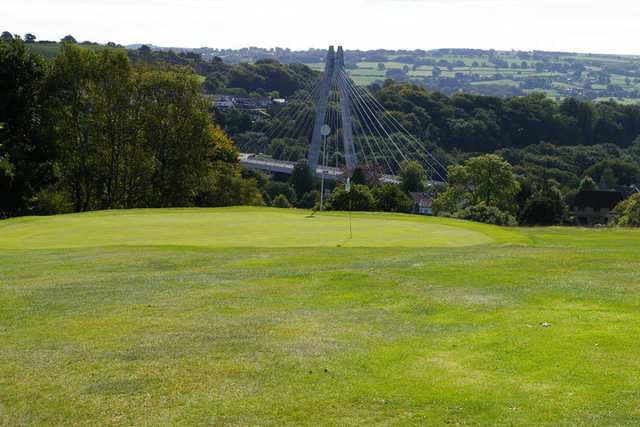 A view of a green with a bridge in background at Blackwood Golf Club