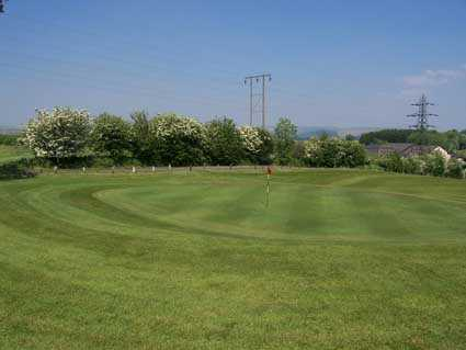 A spring view of a green at Morlais Castle Golf Club