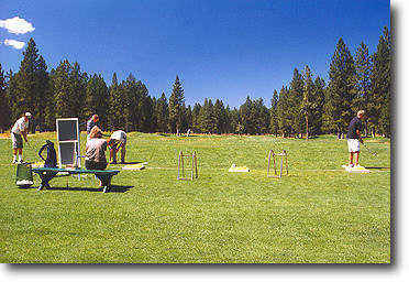 The driving range is open and off of grass. Range balls are complimentary with your greens fees!