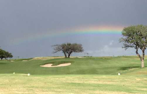 A view of a rainbow over Lady Bird Johnson Golf Club