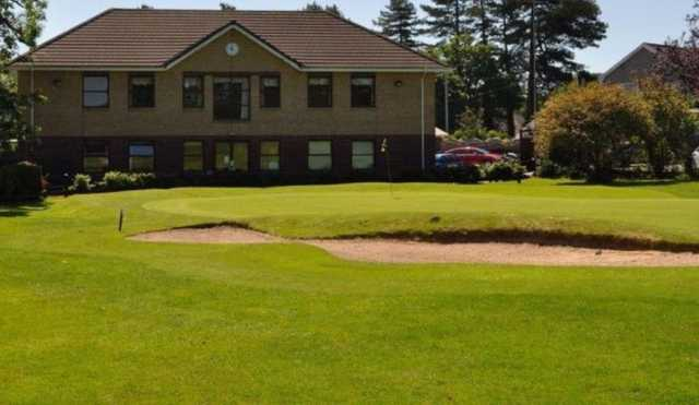 Large bunker protecting the green in front of the clubhouse