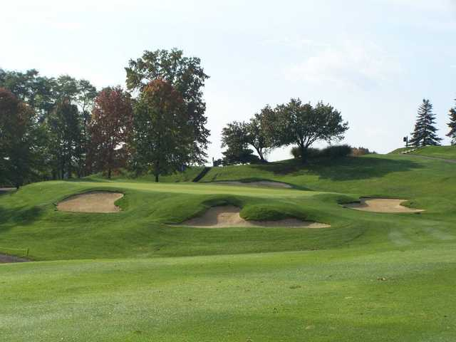 A view of green #8 guarded by bunkers at Armitage Golf Course