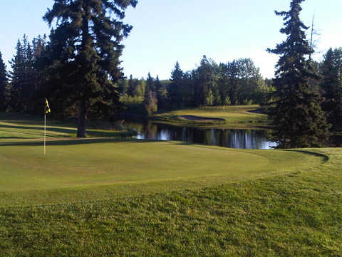 A view of a green with water coming into play at Drayton Valley Golf Club