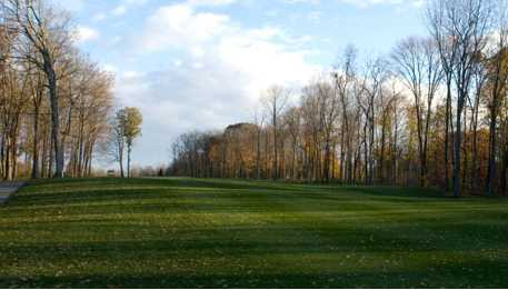 A view of a fairway with narrow cart path on the left side at Safari Golf Club