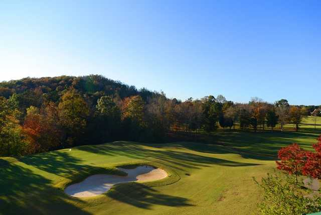 A view of a green protected by an undulating bunker at Cherokee Ridge Country Club