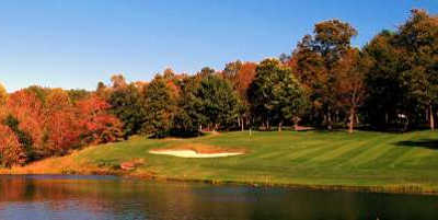 A view over the water of a green at Druid Hills Golf Club