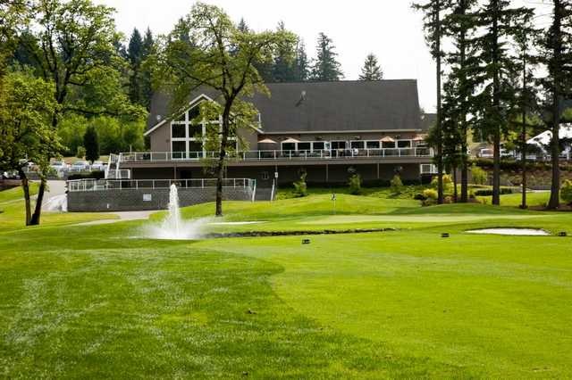 A view of the 18th green and clubhouse in background at Camas Meadows Golf Club