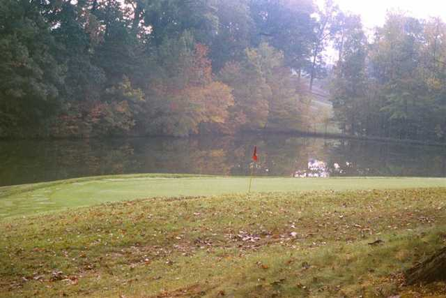 A view of a green with water coming into play at Meadowink Golf Course