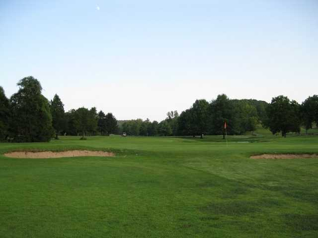 A view of a green protected by bunkers at Deer Creek USA Golf and Event Center