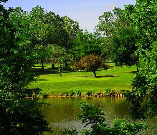 A view over the water of a hole at Cypress Ridge Golf Course