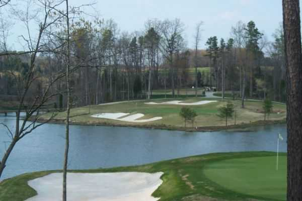 A view over the water of hole #16 at Warrior Golf Club